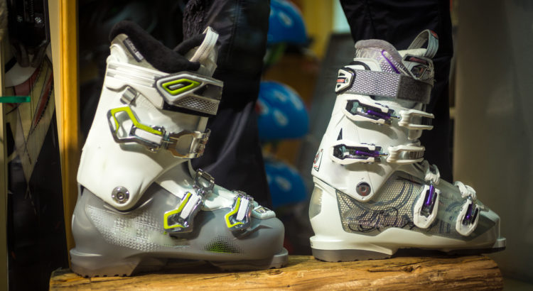 Closeup photo of new ski boots on wooden board