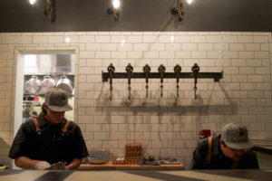 Workers prepare for The Distillery restaurant opening. Photo by Grace Gabree