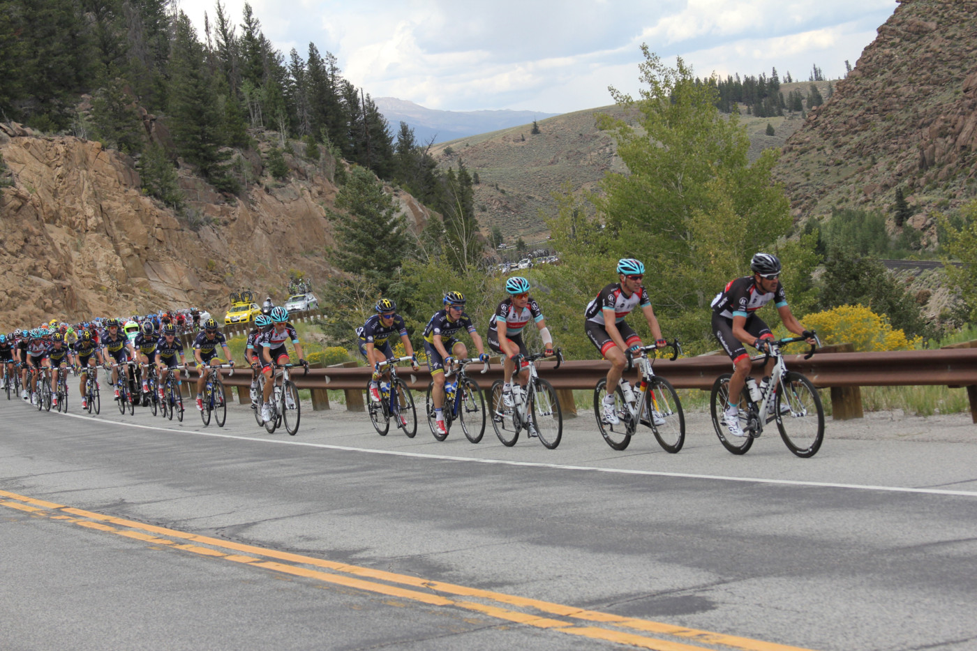 Professional cyclists coming up a mountain road incline/Colorado Classic