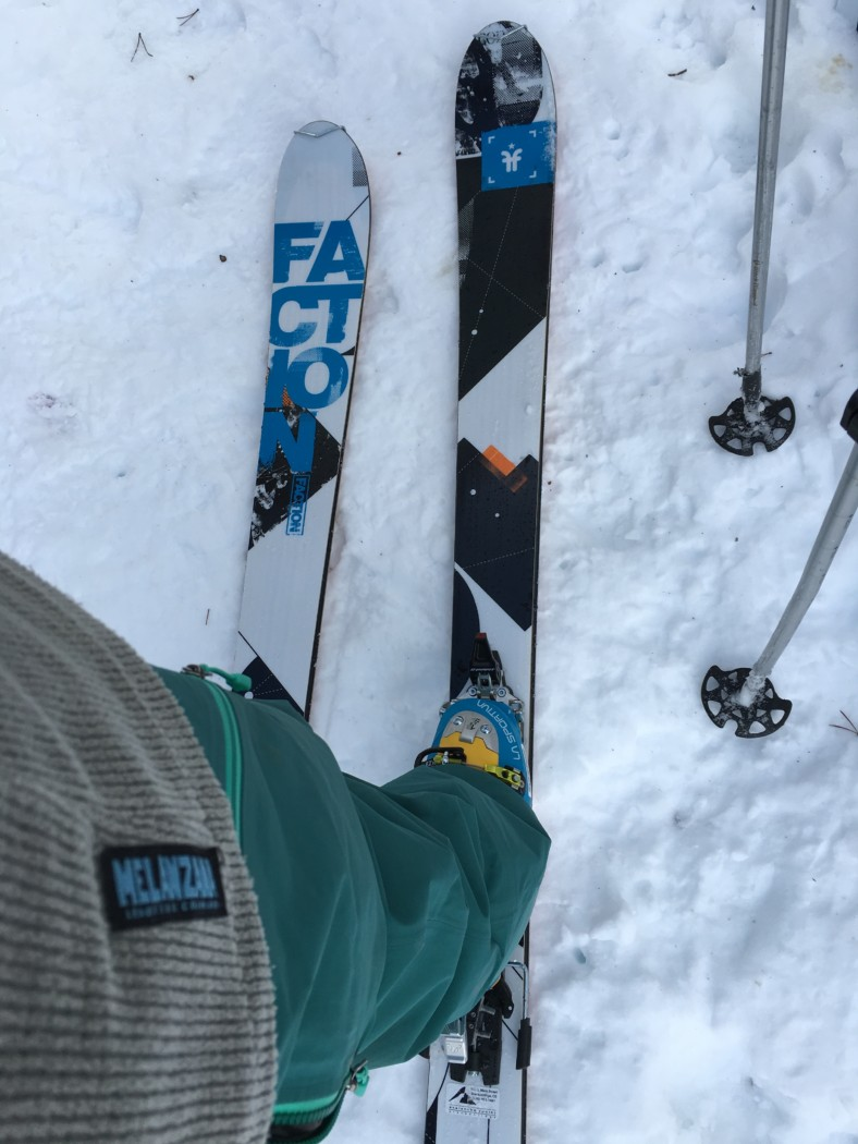 photo looking down at funky pattern on a pair of Faction-brand skis