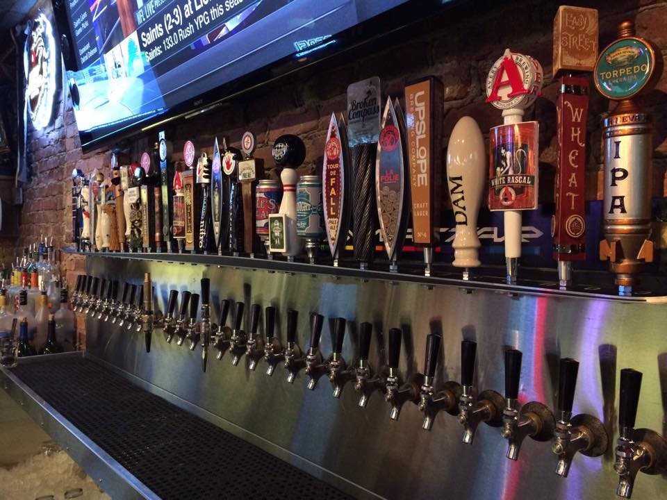 long line of beer taps at Downstairs at Eric's in Breckenridge, Colorado