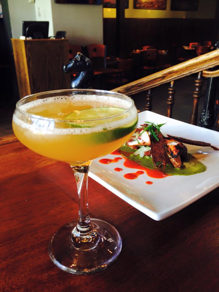 image of a fancy margarita and smoked squid at Modis bar in Breckenridge, Colorado